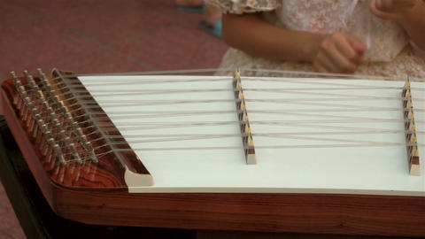 Musician playing the wooden hammered dulcimer Footage