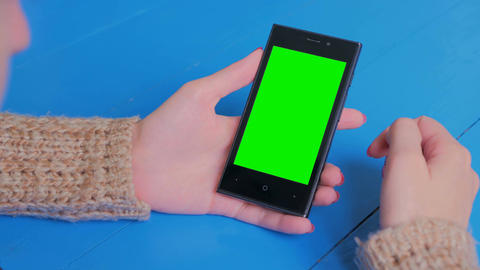 Woman using smartphone with green screen Footage