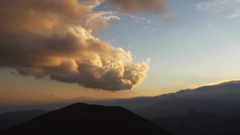 Clouds float over the mountains. Timelapse Footage