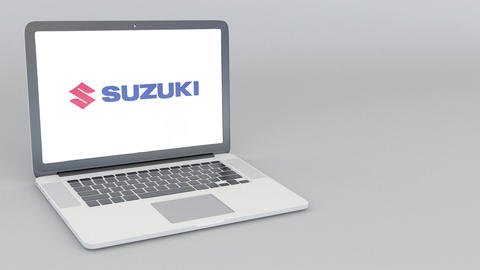 Opening and closing laptop with Suzuki Motor Corporation logo. 4K editorial Live Action