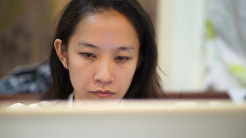 Asian woman girl working concentrated behind laptop computer ビデオ