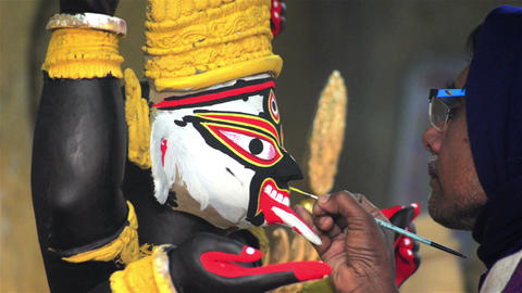 Close shot of an Indian statue maker giving final touch Footage
