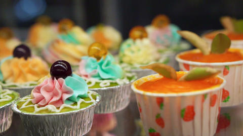 Variety of colourful cupcakes Footage