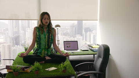 3 Business Woman Doing Yoga Meditation On Table In Office stock footage