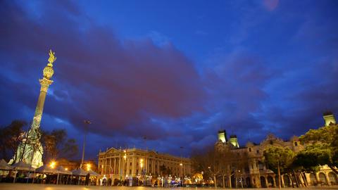Columbus Monument at Portal de la Pau square, nightfall time lapse Live Action