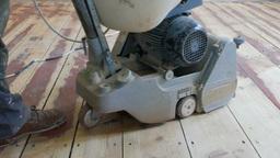 Floor sanding. Sanding machine is removing old oil-color paint Footage