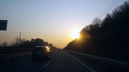 Beautiful sunset on the driving road Footage