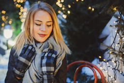 Portrait Beautiful blonde young caucasian woman in black coat and scarf Photo