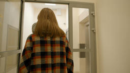 Young Women is Coming in the Entrance of House, Calls the Elevator and Enters it Footage