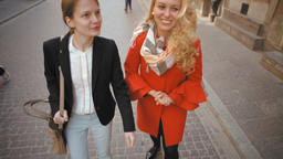 Slow Motion of Two Young Nice Ladies Walking in Old Town,... Stock Video Footage