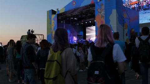 Camera Moves Fast around Spectators Watching Concert Footage