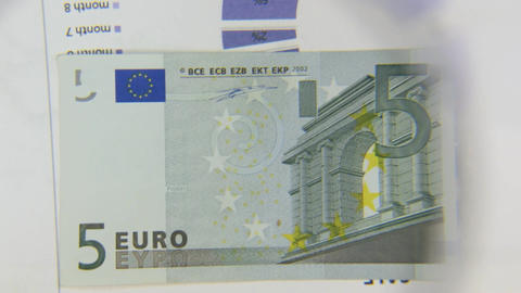 Consider a banknote of five euros, an increase with a magnifying glass Footage