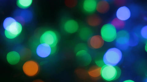 Rotating multicolored bokeh lights. Christmas and new year lights twinkling Footage