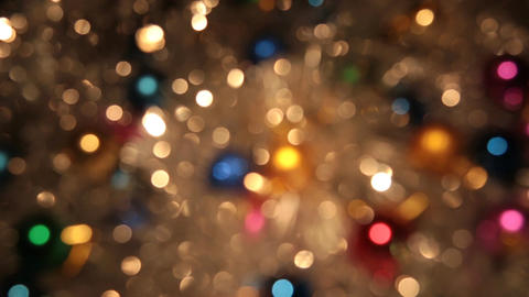 Rotation bokeh from golden tinsel and colorful balls. Christmas and new year Footage