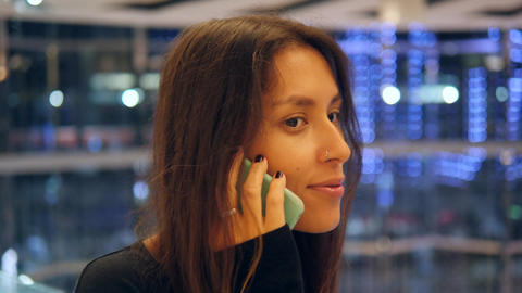 Young Smiling Woman Speaking on Mobile Phone in Shopping Mall. Attractive Mixed Footage