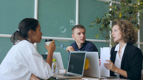 Mixed Race Group of Young People Discussing Something while Sitting at the Footage