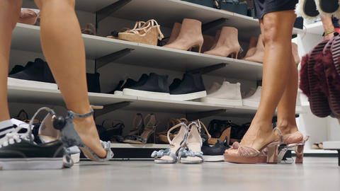 Women Customers Trying On New Fashion Vegan High Heels at Clearance Sale in Shoe Footage