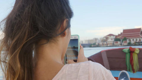 Young Happy Tourist Girl Sails on a Boat on River and Taking Video on Mobile Footage