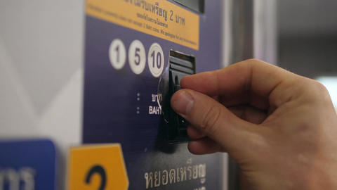 Close Up of Woman's Hand Paying by Coins Subway Ticket in Automatic Vending Footage