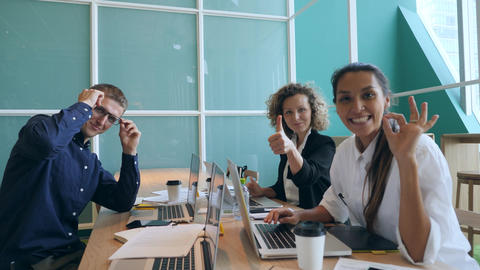 Group of Young Mixed Race Business People Showing Thumbs Up in Office. Start-up Footage