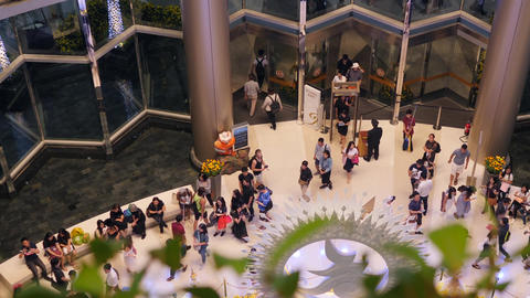 Many Tourists at Entrance in Siam Paragon Shopping Centre. 4K. Bangkok, Thailand Footage