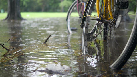 Flooding Cataclysm in Thailand. Bicycles Standing in Deep Water Puddle. Heavy Footage