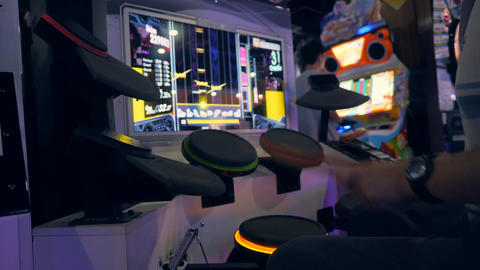 Young Asian Man Playing Drums Game on Music Arcade Machine Pads in Game Zone MBK Footage