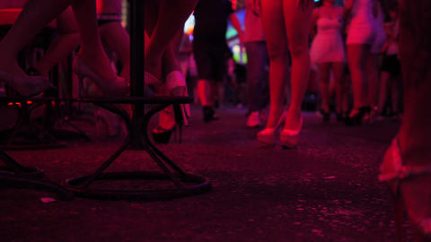 Strip Bar Girls in High Heels Shoes Waiting for Clients at Soi Cowboy Street. 4K Footage
