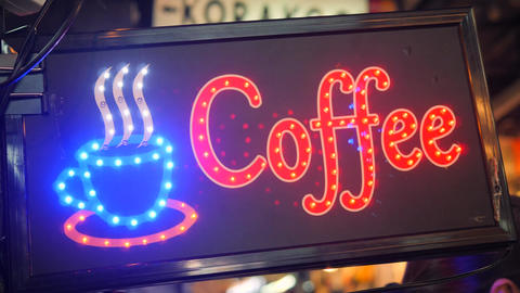 Blinking Led Coffee Shop Street Sign with Beautiful Unfocused Bokeh Effect. 4K Footage