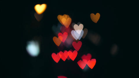 Amazing Hearts Bokeh from Car Lights at Night Street Traffic Jam in Bangkok Live Action