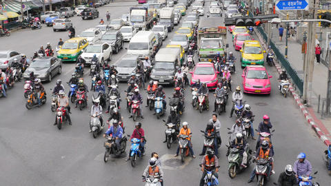 Time Lapse: Motorbikes and Cars at Busy Traffic Road near Asok BTS Subway Train Footage