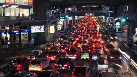 Night Cars Time Lapse at Busy Traffic Road near Siam BTS Subway Train Station Footage