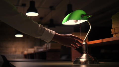 Female Hand Turned Off Green Table Lamp in Office. 4K Footage