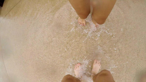 Young Carefree Happy Couple Jumping Barefoot in Puddle and Having Fun at Rainy Footage