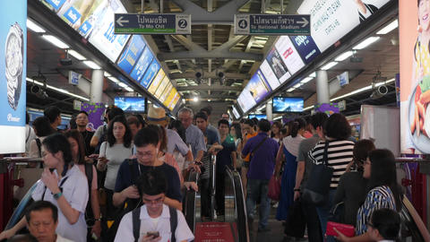 Crowds of People on Moving Escalator at Siam BTS Station in Rush Hour. 4K Footage
