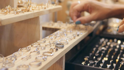 Closeup of Female Hand Customer Shopping at a Jewelry Store Trying On Golden Footage