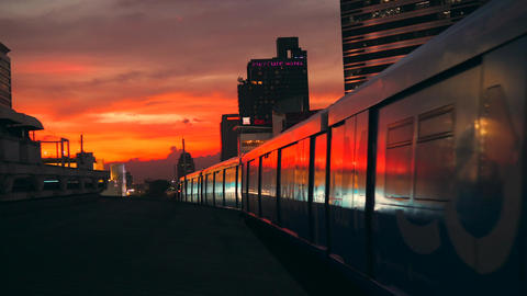 Beautiful Golden Sunset in Bangkok City with BTS Metro Subway Train Leaving from Footage