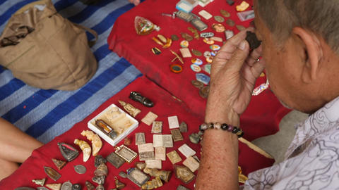Old Asian Man Choosing Old Buddhist Pendant Necklace Talusman at Chatuchak Footage