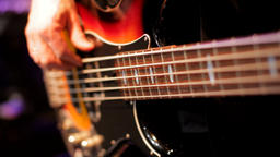 Bass Player Hands Playing Rock Music with Bass Guitar in the Nightclub Concert Footage