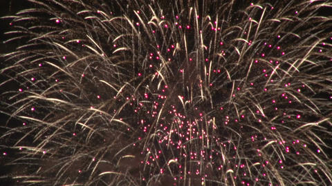 Sparkly gold fireworks exploding Footage