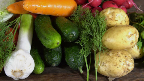 Fresh vegetables on a wooden table Footage