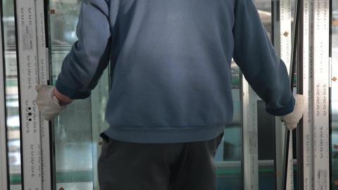 Worker installing a double-glazed window Footage