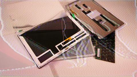 Grainy laptop disassemble Live Action