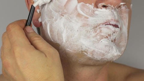 Closeup shave a man, shaving razor with a blade. HD Footage