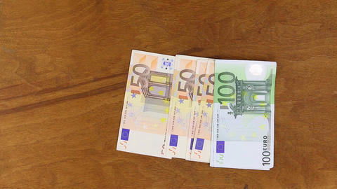 Throw euros on a wooden background.HD Footage