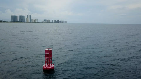 Buoy Floating In The Ocean With West Palm Beach Skyline In The Back Footage