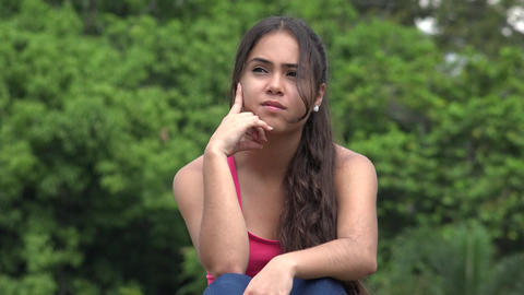 Hispanic Female Teen Thinking Live Action