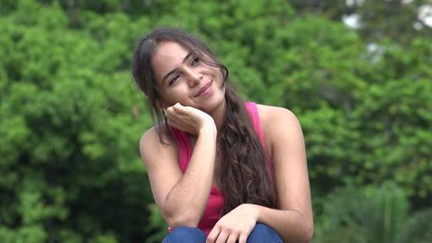 Young Hispanic Female Teen Wondering Live Action