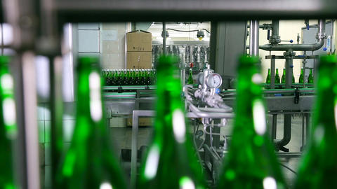 Bottles of green color move along conveyor Footage