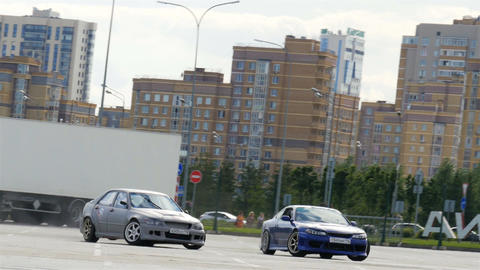 Grey and Blue Powerful Sports Cars Race and Show Drift Tricks Live Action